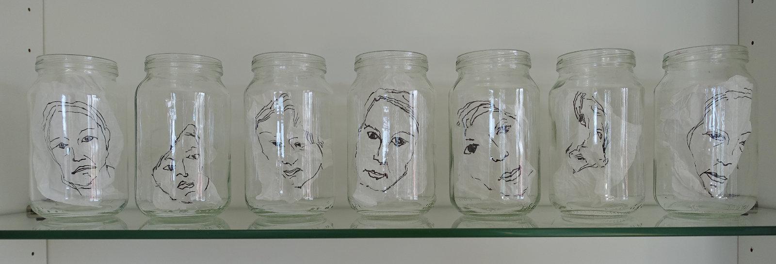 Väsymyksen kasvot, 2016, rypistellyt piirustukset lasipurkeissa, 12 x 48 x 6 cm
